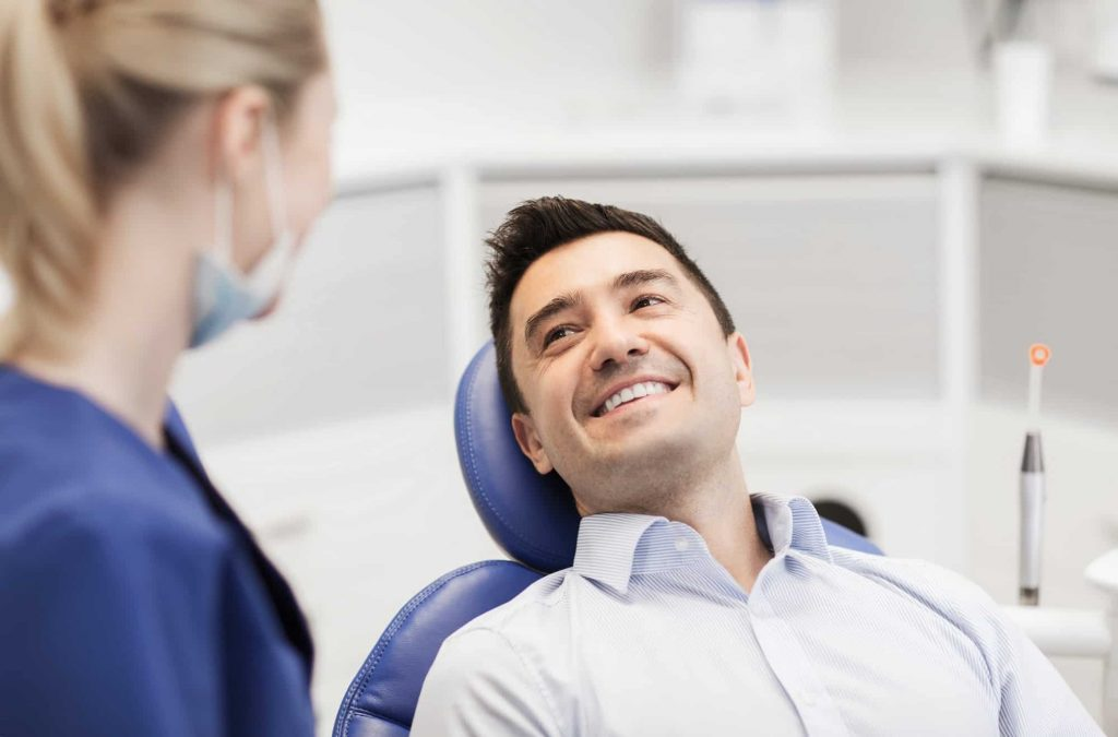 The Pros and Cons of Dental Implants Versus Bridges